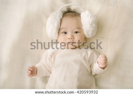 Baby's parents teasing baby - stock photo