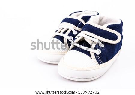 Baby shoe on isolated white background - stock photo