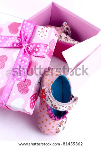 Baby shoes in a box - stock photo