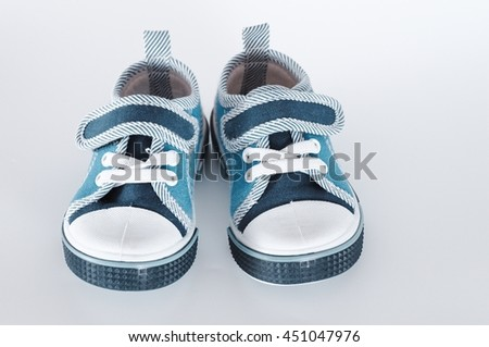 Baby shoes on a white background.