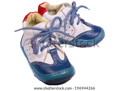 Baby shoes with laces on white background - stock photo