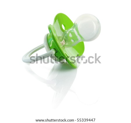 Baby silicone pacifier in green color, isolated on white background. - stock photo