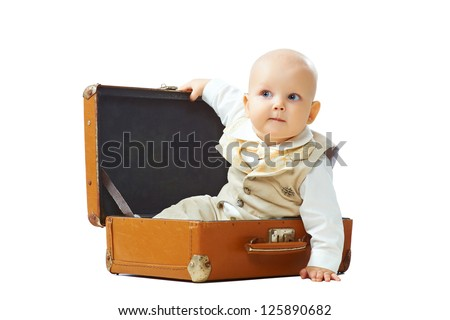 Baby sit in old-fashioned suitcase isolated on white background - stock photo