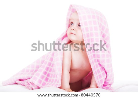 baby siting under towel - stock photo