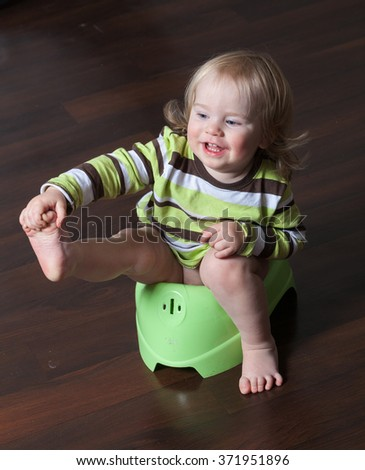 baby sitting on a pot - stock photo