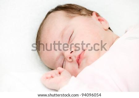 baby sleep under a white blanket - stock photo