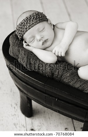 Baby sleeping in a prop - stock photo