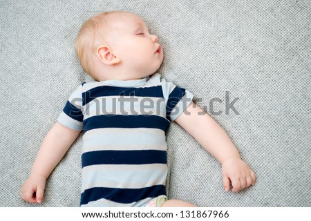 Baby sleeping on the bed - stock photo
