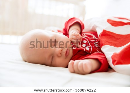 Baby sleeps in a crib - stock photo