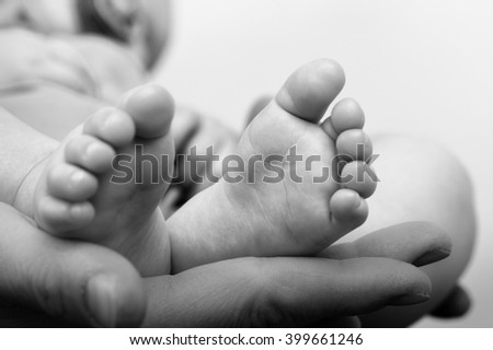 Baby sleeps in the arms of mom - stock photo