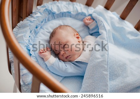baby sleeps with a cradle - stock photo