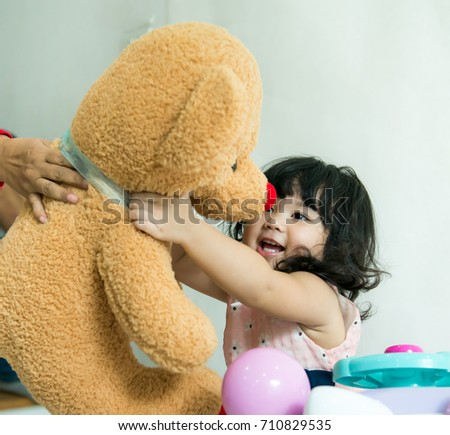 Baby happy big teddy bear doll stock photo 100 legal protection baby so happy with big teddy bear doll soft toy happy sweet asian girl hugging publicscrutiny Choice Image