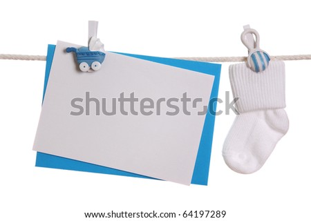 Baby sock and blank note hanging on the clothesline - stock photo