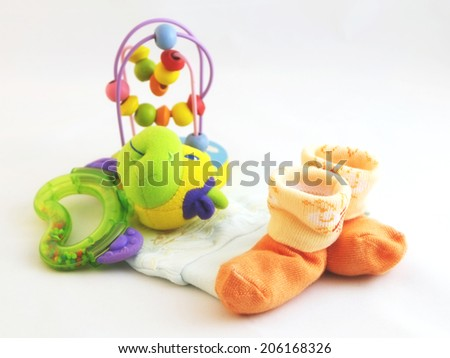 baby socks, hat and toy. - stock photo