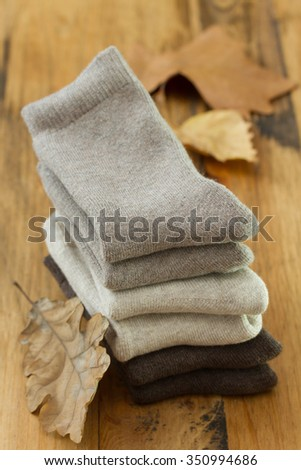 baby socks on brown wooden background
