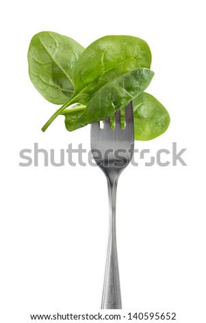Baby spinach leaves on a fork - stock photo