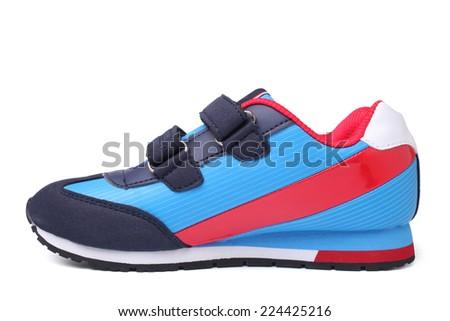 Baby sport shoe on white background - stock photo