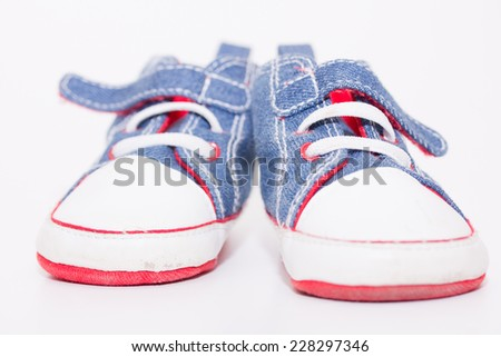 Baby sport shoes pair on white background - stock photo