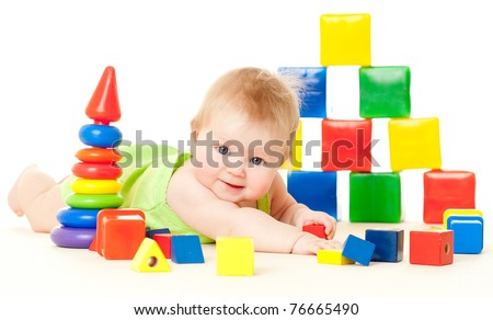 baby, surrounded by toys on a white background - stock photo