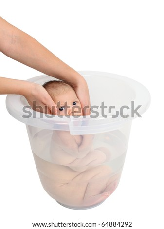 Baby taking a bath in bucket - stock photo