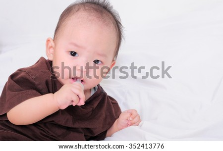 baby taking medicine with dropper