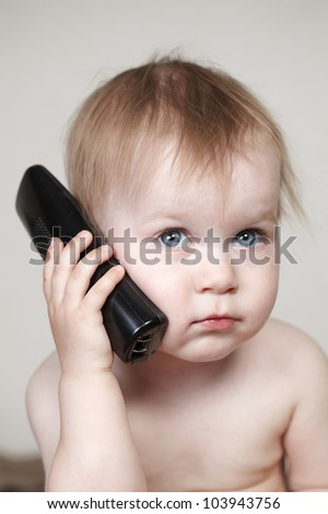 baby talking on phone - stock photo