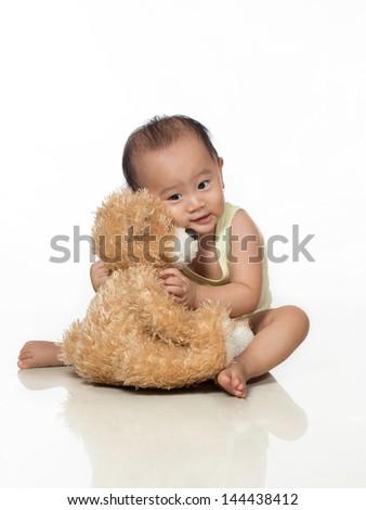 baby / toddler love generic teddy bear - stock photo