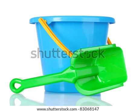 baby toy bucket and shovel isolated on white - stock photo