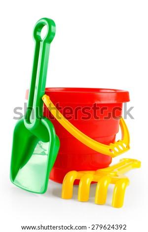 Baby toy bucket and shovel rake isolated on white background - stock photo