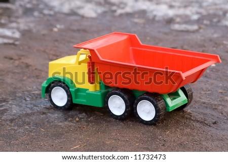 baby toy dump truck in dirt - Toy Dump Trucks