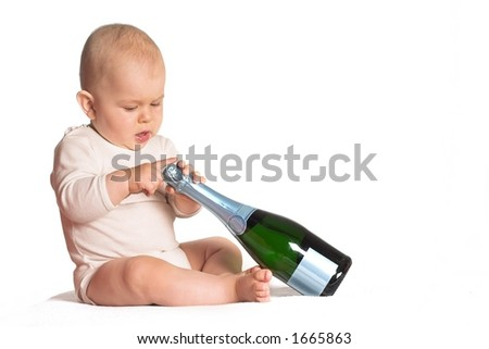 Baby tries to open a bottle of champagne. A good photo for congratulations or celebrations or to symbolize success.