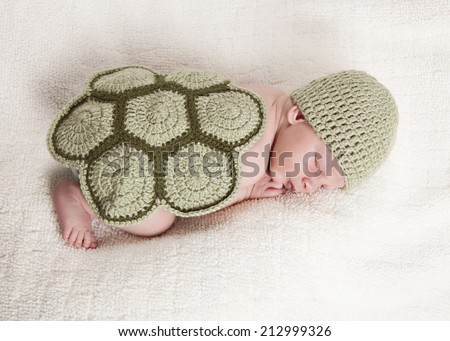 Baby Turtle.  Adorable newborn wearing a turtle costume. - stock photo