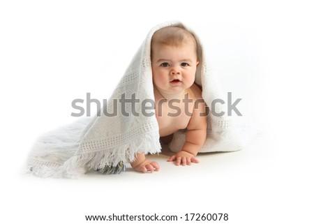 Baby under blanket on white background - stock photo