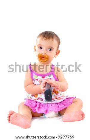 Baby using an remote control on white .