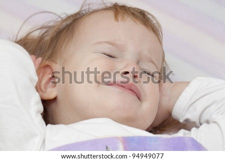 Baby' waking up in bed unhappy