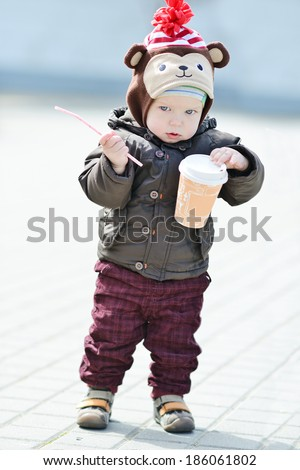 baby walker and his first steps - stock photo