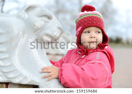 baby walking in park and touching bench - stock photo
