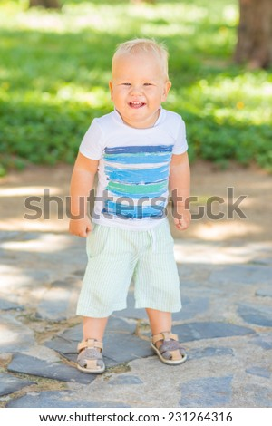 Baby walking in the park - stock photo