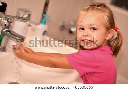 baby washing hand - stock photo