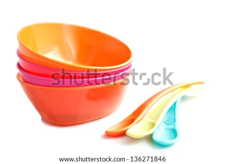 Baby weaning bowls with the spoons on a white background, selective focus - stock photo