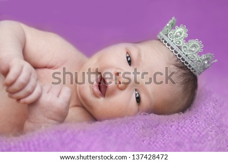 baby wearing a crown - stock photo