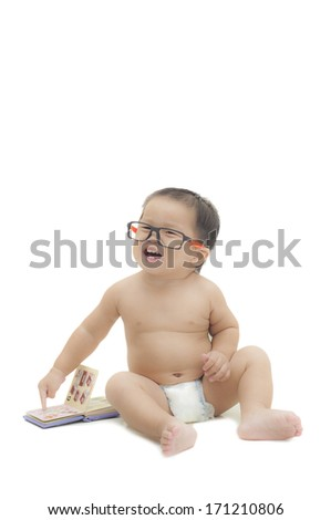 baby wearing eyeglasses pointing a book white isolated. - stock photo