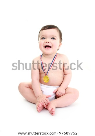 Baby wearing medal laughing - stock photo
