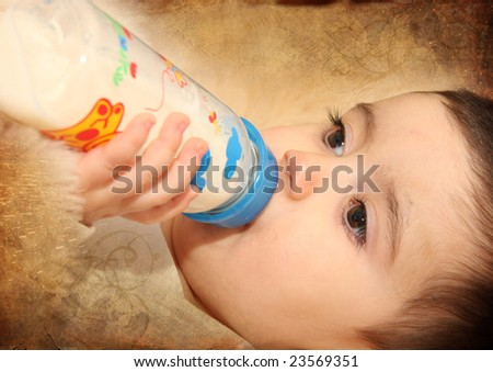 baby with a blue bottle - stock photo