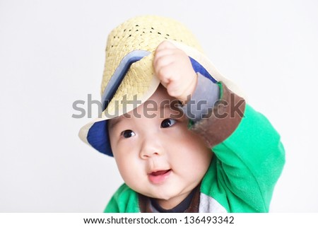 baby with a cowboy hat - stock photo