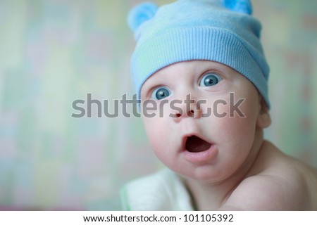 baby with a funny expression on his face - stock photo