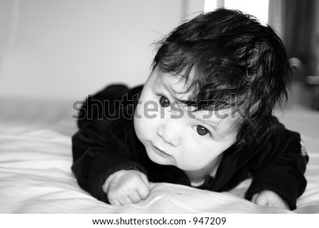Baby with a wise looking expression on the face - stock photo