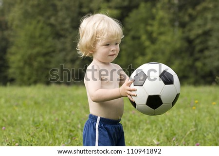 Baby with  ball in the park