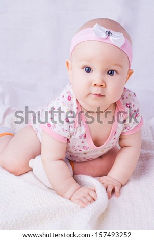 Baby with blue eyes smiling, 7 month newborn baby