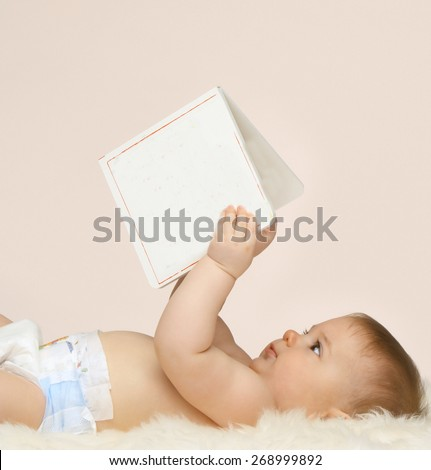 baby with book - stock photo
